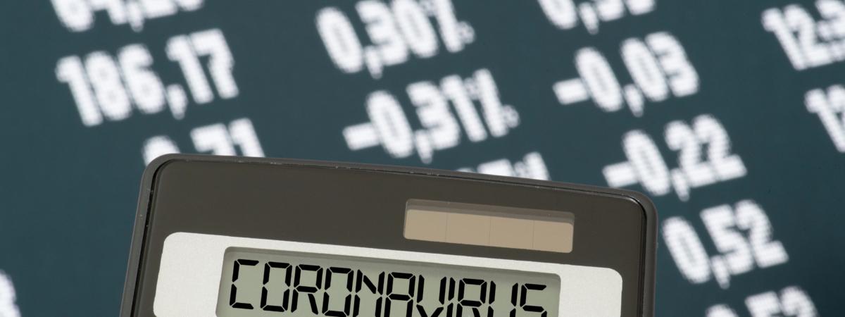 Stock exchange, calculator and coronavirus
