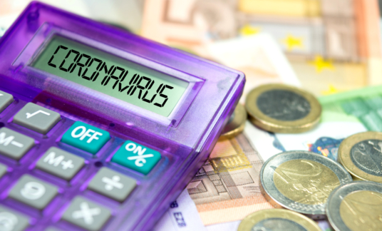 Calculator, Euro banknotes and coronavirus in Europe –
