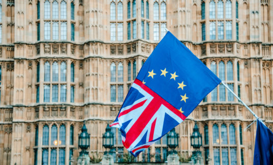 UK and EU flags merged by Houses of Parliament