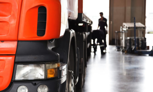 automobile mechanic checking truck in the garage, selective focus