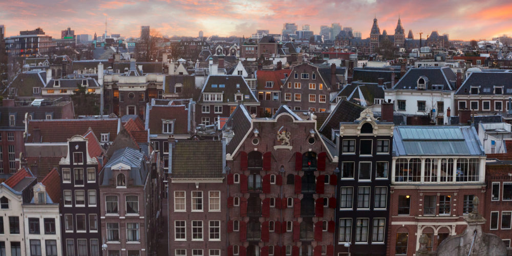 Roofs of Amsterdam at sunset,  Netherlands. Top view of old-time houses in Amsterdam, Netherlands.