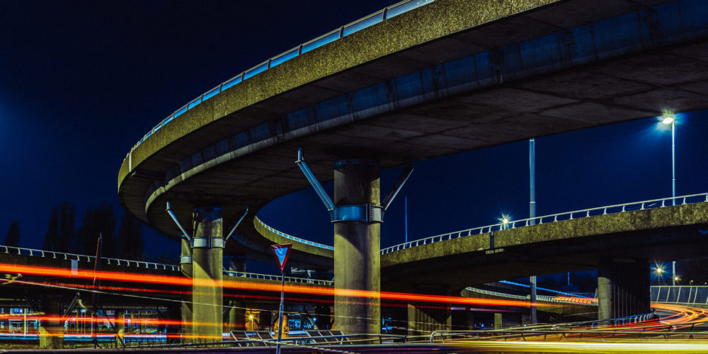 transportation highway system long exposure , urban sprawl interstate and interchange loops and turnarounds on highway
