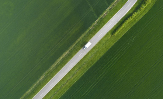 Road through agricultural area – aerial view