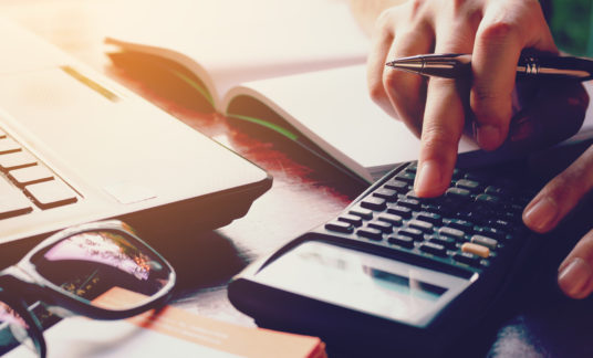 Close up woman doing finance with calculate expenses.