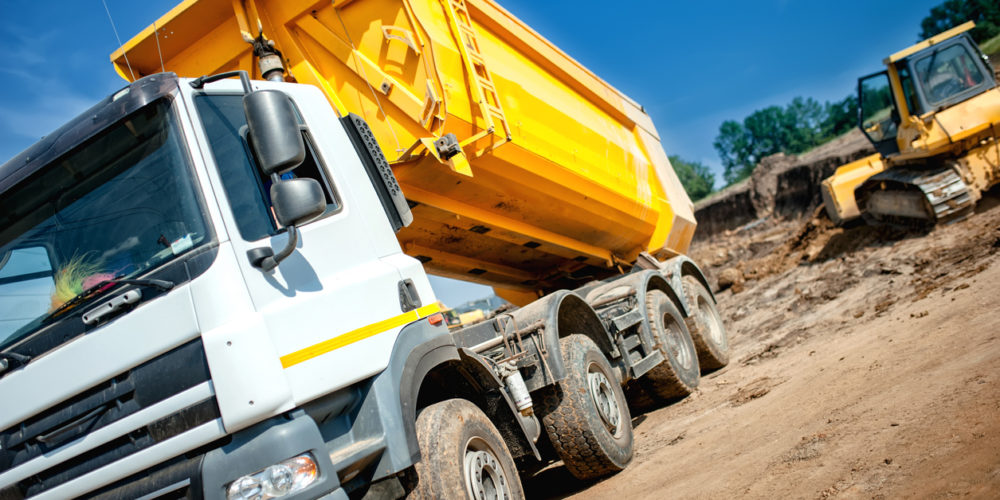 dumper truck at industrial constrution site waiting for earth load